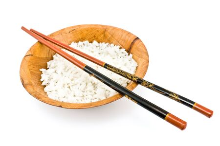 Bamboo bowl with rice and chopsticks isolated on white photo