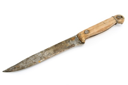 Old rusty knife with wooden handle isolated on white photo