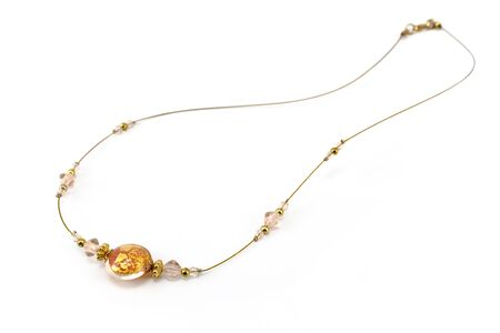 Antique golden necklace isolated on white Stock Photo - 12367559