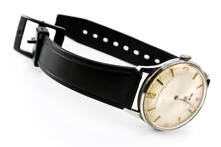 Old broken wristwatch with black strap isolated onwhite  photo
