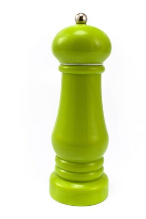 cooking utensils: Green pepper mill isolated on white