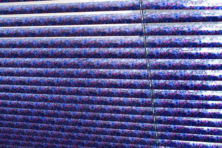 window coverings: Venetian blinds as background in front of blurred glass