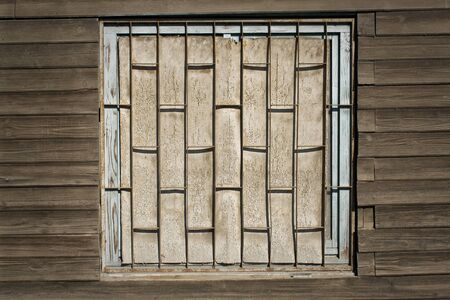 boarded: Old wooden wall with boarded up window as background Stock Photo