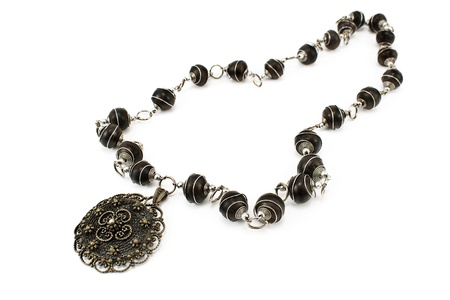 Black metal necklace isolated on white