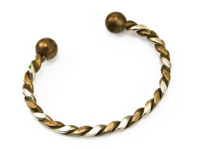 Ornate metal bracelet isolated on white  Stock Photo - 13028129