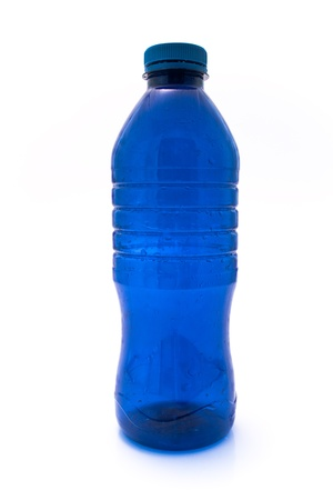Blue plastic bottle isolated on white  photo