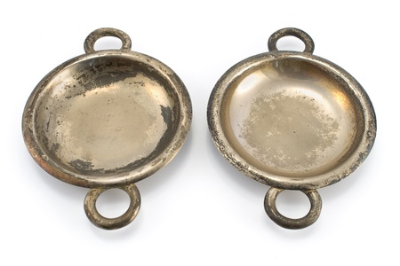 showpiece: Two antique silver ashtrays isolated on white