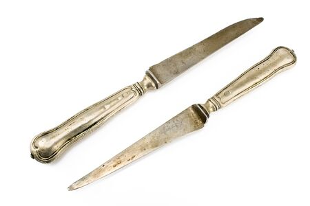 Two vintage table knifes isolated on white Stock Photo - 13207294