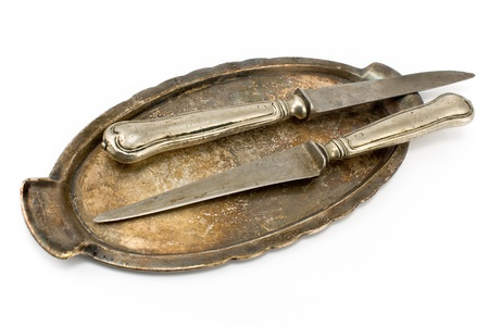 Two antique table knifes on tray isolated on white Stock Photo - 13207303
