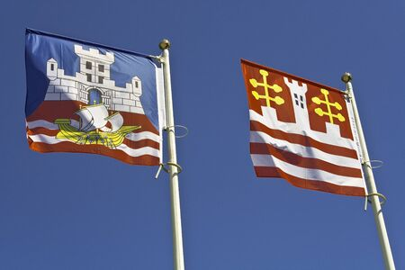Belgrade and Old Town flag against blue sky photo