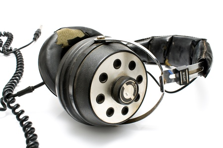preamp: Pair of old headphones isolated on a White