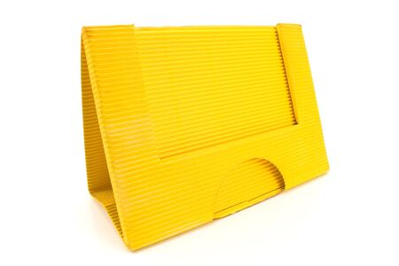 Yellow cardboard paper holder isolated on white photo