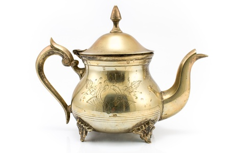ware: Antique silver teapot isolated on white
