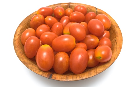 Plum tomatoes in wooden dish isolated on white Stock Photo - 13947373