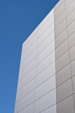 Steel facade on modern building over blue sky