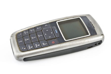whitw: Old dusty mobile phone isolated on whitw