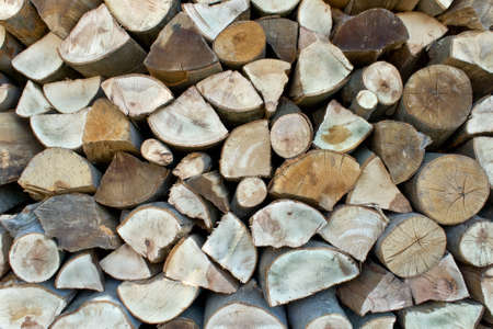 Chopped firewood logs in a pile as background Stock Photo - 14341538