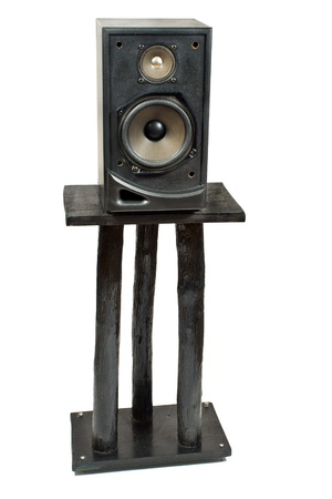 Black sound speaker on stand isolated on white photo
