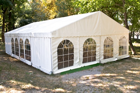 tent: White big tent in forest Stock Photo