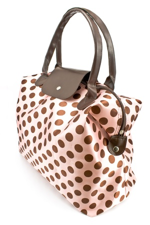 Polka dot bag isolated on white photo