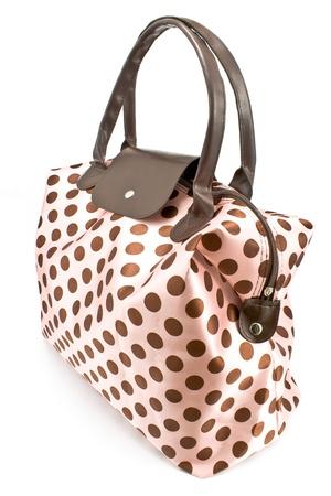 Polka dot bag isolated on white photo