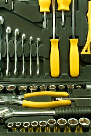 Set of various chrome yellow tools in black box  photo