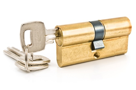 key hole: Brass cartridge cylinder with keys isolated on white Stock Photo