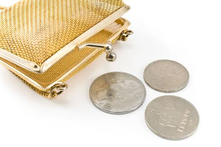 Golden purse with old european coins isolated on white photo