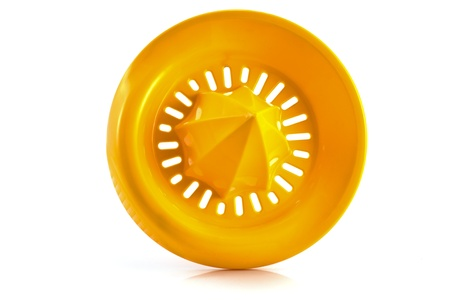 Orange plastic lemon squeezer isolated on white photo