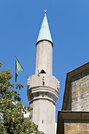 flad: Minaret of mosque in Belgrade over blue sky