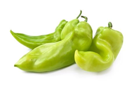 흰색 배경에 고립 된 세 개의 녹색 고추 스톡 사진
