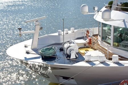 glistening: Bow and deck of the ship beside glistening water Stock Photo