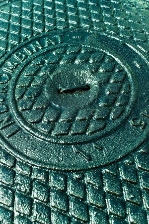 Iron sewer cover as background Stock Photo - 15080775