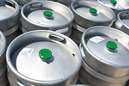 beer production: Metal beer barrels as background