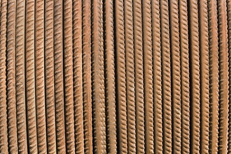 Rusty steel rod as background photo