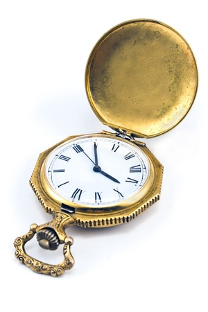 Antique gold pocket watch isolated on white photo