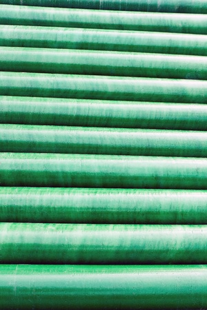 Texture of green plastic pipe as background photo