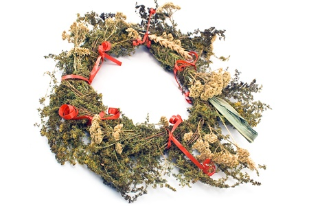 Wreath of dry herbs isolated on white background photo
