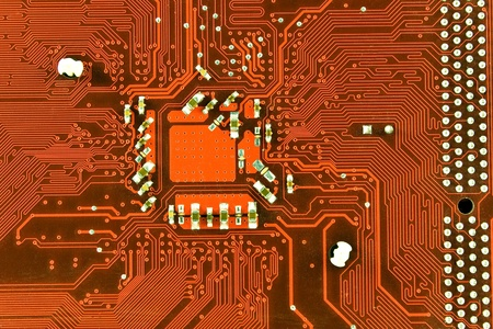 Close up of red computer circuit board photo
