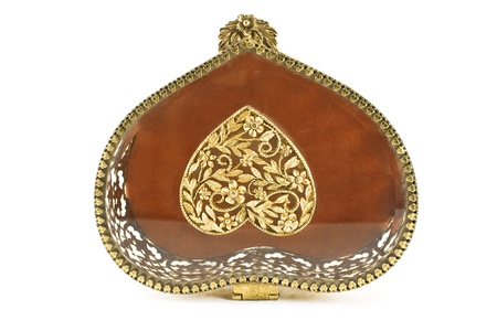 Lid of golden antique jewelry box on white photo