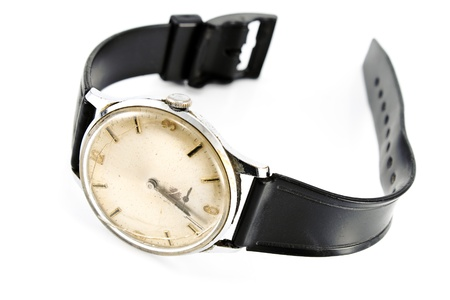 wrist strap: Old broken wristwatch with black strap isolated on white Stock Photo