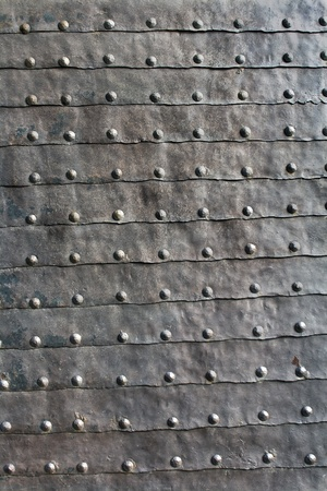 Medieval iron door texture as background photo