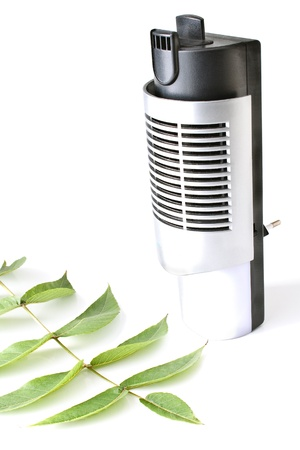 ionizing: Electric air humidifier with leaf isolated on white