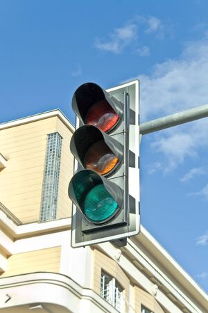 Traffic lights against sky backgrounds photo
