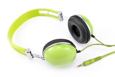 Green headphones isolated on white background photo