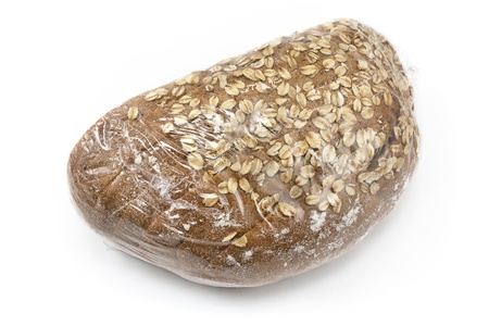 cellophane:  Baked bread with seeds wrapped in cellophane isolated on white