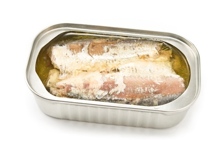 Sardines in opened tin can isolated on white photo