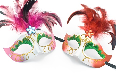 Two Carnival mask with feathers and diamond isolated on white photo