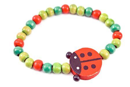 Wooden beads bracelet with ladybug isolated on white Stock Photo - 17695039