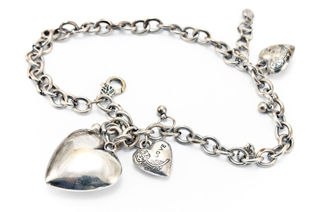 silver jewelry: Silver necklace  with heart pendants isolated on white Stock Photo